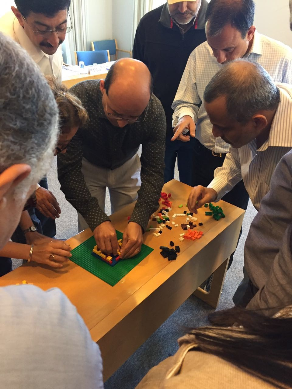 The program was a creative mix of lectures, groups work, class discussions and practical exercises. The picture portrays one such exercise, where the participants were challenged to build a structure with LEGO in silence, with different and secret instructions.